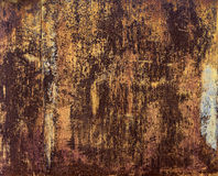 Rusted metal surface with paint residues Stock Photography