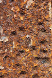 Rusted metal texture. Rusted metal with orange, yellow, and red patina Stock Photo