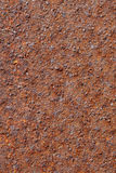 Rusted metal texture. Rusted metal with orange and red patina Stock Photos