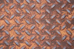 Rusted Metal Tread. Closeup of a rusted metal tread of a loading ramp.  For background use Royalty Free Stock Photography