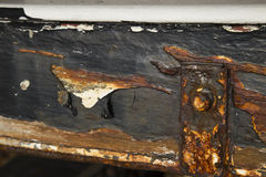 Rusted metal work on a boat hull Stock Photography