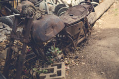 Rusted Motorcycle. Old motorcycle chassis in art/scrap yard. Well rusted and aged patina Stock Images