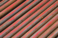 Rusted ms steel pipes diagonally arranged. Rusty MS Steel Pipes kept at a factory for fabrication. useful for textures and backgrounds stock photography