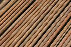 Rusted ms steel pipes diagonally arranged background. Rusty MS Steel Pipes kept at a factory for fabrication. useful for textures and backgrounds royalty free stock images
