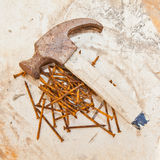 Rusted nails and old hammer Stock Image