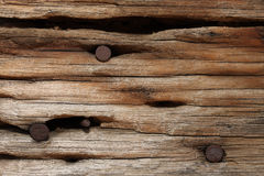 Rusted nails in old wood Stock Photos