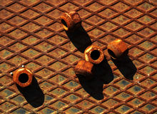 Rusted nuts Stock Images