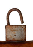Rusted old hanging lock Royalty Free Stock Images