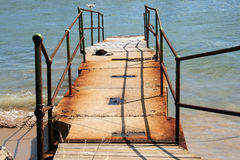 Rusted old jetty. A rusted old jetty leading into the harbour that has now been closed royalty free stock image