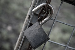 Rusted Old Lock on a Metal Chain. Royalty Free Stock Photos