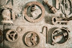 Rusted old mechanical tools well sorted on the bench wooden workshop.  royalty free stock images