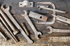 Rusted old mechanical tools well sorted on the bench workshop Royalty Free Stock Photos