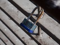 Rusted old metal love lock attached to iron railings of a bridge. Rusted old metal love lock padlock attached to the iron railings of a bridge in Dublin, Ireland stock image