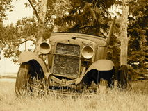 Rusted Out Antique Car In Sepia Tone Stock Photography