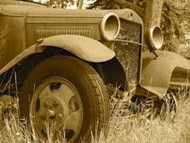 Rusted Out Antique Car In Sepia Tone Royalty Free Stock Images