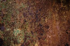 Rusted and oxidized metal texture. Background of the old ferrum sheet. Grunge wall with streaks of pitting. Concept of abstract. Corroded iron. Place for text stock image