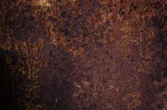 Rusted and oxidized metal texture. Background of the old ferrum sheet. Grunge wall with streaks of pitting. Concept of abstract. Corroded iron. Place for text royalty free stock photography