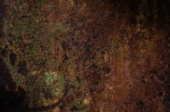 Rusted and oxidized metal texture. Background of the old ferrum sheet. Grunge wall with streaks of pitting. Concept of abstract. Corroded iron. Place for text stock photo