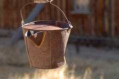 Rusted pail hanging in deserted gold mining town Stock Photo