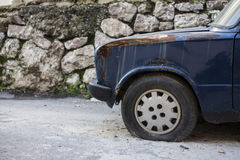 Rusted paint and flat tire Stock Photography