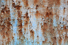 Rusted paint texture. Close up of texture of old cracked rusted painted door Royalty Free Stock Photo