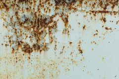 Rusted painted metal wall. Rusty metal background with streaks of rust. The metal surface rusted spots Royalty Free Stock Image