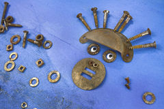 Rusted parts face. Creative fun, face from rusty parts on blue canvas Royalty Free Stock Photo