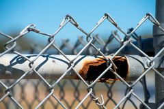 Rusted pipe on fence Stock Photo