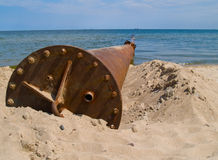 Rusted pipe in sea. Old rusted iron pipe dripping  in clear sea Stock Images