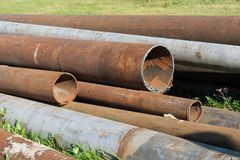 Rusted pipelines. Few old rusted iron pipelines from heating system royalty free stock photo