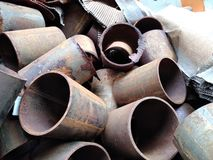 Rusted Pipes. Rusty piece pieces segment segments recycling recycle debris pile piled many lot much construction repair repairs make site sites maintenance royalty free stock photography