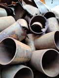 Rusted Pipes. Rusty piece pieces segment segments recycling recycle debris pile piled many lot much construction repair repairs make site sites maintenance stock images