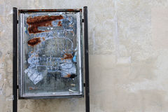Rusted placard and empty wall background. Stock Photos