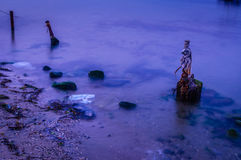 Rusted Poles On The Sea Royalty Free Stock Images