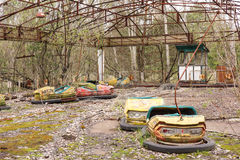 Rusted pumper cars in Pripyat city. Rusted and broken bumper cars in Pripyast city, Ukraine Royalty Free Stock Images