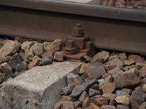 Rusted rail bolt. Close up image of a railway track and bend and a rusted bolt Royalty Free Stock Photo