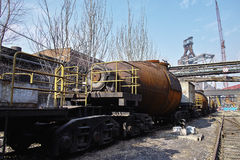 Rusted rail vehicle in abandoned steel works Stock Photos