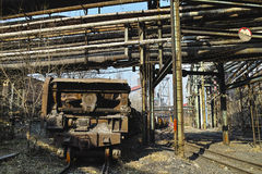 Rusted rail vehicle in abandoned steel works Stock Images