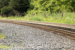 Rusted railroad track. Brown, rusted railroad tracks on rock gravel Stock Photos