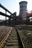 Rusted railway and abandoned steelmaking equipments Royalty Free Stock Image