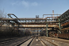 Rusted railway and abandoned steelmaking equipments Stock Photo