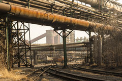Rusted railway and abandoned steelmaking equipments Royalty Free Stock Photo