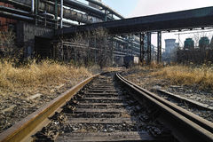 Rusted railway and abandoned steelmaking equipments Stock Photography