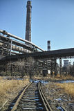 Rusted railway and abandoned steelmaking equipments Stock Images