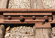 Rusted railway ties linked with bolts. Royalty Free Stock Photography