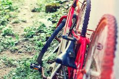 Rusted red vintage bicycle at wall stock photography