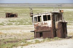 Rusted remains of fishing boats,  Aralsk, Kazakhstan. Royalty Free Stock Photo