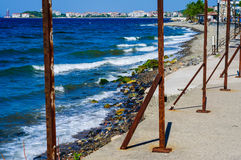 Rusted Safery Bars On Shoreline Stock Photo