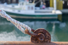Rusted by saltwater pulley and old rope on a working lobster boa Royalty Free Stock Photos