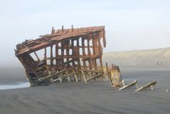 Rusted Shipwreck. The remains of a shipwreck from the 1800s, on a beach in Ecola State Park in Oregon Royalty Free Stock Photos